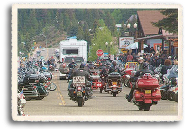 Bikers attending the Red Reiver Memorial Weekend Motorcycle Rally head out from Red River for the Motorcycle Parade to the Vietnam Veterans memorial in Angel Fire, NM